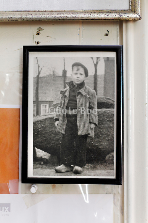 framed old photo of young boy in farmer style clothing Holland