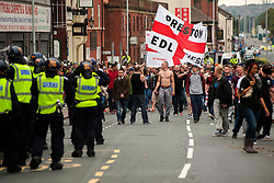 """Rotherham England<br /> 13 September 2014 <br /> Police Officers in riot kit try to get EDL members and Supporters back onto the official route after the EDL broke through a police cordon during the English Defence League Justice for the Rotherham 1400 March described by an EDL Facebook Page as """"a protest against the Pakistani Muslim grooming gangs"""" on Saturday Afternoon <br /> <br /> <br /> Image © Paul David Drabble <br /> www.pauldaviddrabble.co.uk"""