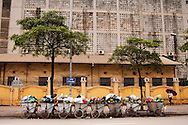 A fashionable woman walking under an umbrella is an elegant contrast to the trash dumpsters awaiting pickup in Hanoi. Robert Dodge, a Washington DC photographer and writer, has been working on his Vietnam 40 Years Later project since 2005. The project has taken him throughout Vietnam, including Hanoi, Ho Chi Minh City (Saigon), Nha Trang, Mue Nie, Phan Thiet, the Mekong, Sapa, Ninh Binh and the Perfume Pagoda. His images capture scenes and people from women in conical hats planting rice along the Red River in the north to men and women working in the floating markets on the Mekong River and its tributaries. Robert's project also captures the traditions of ancient Asia in the rural markets, Buddhist Monasteries and the celebrations around Tet, the Lunar New Year. Also to be found are images of the emerging modern Vietnam, such as young people eating and drinking and embracing the fashions and music of the West. His book. Vietnam 40 Years Later, was published March 2014 by Damiani Editore of Italy.