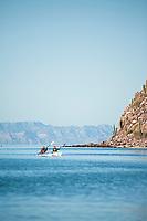 Young women kayaking on Isla Espiritu Santo in the Sea of Cortez, Mexico.