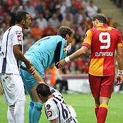 Galatasaray's Johan Elmander (R) and Kasimpasa's goalkeeper Andreas Isaksson (C) during their Turkish Super League soccer match Galatasaray between Kasimpasa at the TT Arena at Seyrantepe in Istanbul Turkey on Monday 20 August 2012. Photo by TURKPIX