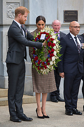 The Duke and Duchess of Sussex prepare to lay a wreath during a visit to the newly unveiled UK war memorial and Pukeahu National War Memorial Park, in Wellington, on day one of the royal couple's tour of New Zealand.