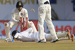 July 27, 2017 - Galle, Sri Lanka - Sri Lankan cricketer Upul Tharanga survives a run out as he dives in while  Indian Wicket keeper Wriddhiman Saha (L) removes the bails during the 2nd Day's play in the 1st Test match between Sri Lanka and India at the Galle International cricket stadium, Galle, Sri Lanka on Thursday 27 July 2017. (Credit Image: © Tharaka Basnayaka/NurPhoto via ZUMA Press)