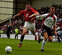 Fotball<br /> Foto: SBI/Digitalsport<br /> NORWAY ONLY<br /> <br /> Clyde v Manchester United, Preseason Friendly. 16/07/2005.<br /> <br /> Manchester United's Wayne Rooney (L) in action.