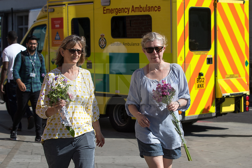 © Licensed to London News Pictures. 19/06/2017. London, UK. Flowers being left in memory of the dead and injured , outside Finsbury Park Mosque . One man is known to be dead and several inured after a hired van was driven in to people on Whadcoat Street in Finsbury Park in North London after late night prayers at a nearby mosque . Photo credit: Joel Goodman/LNP