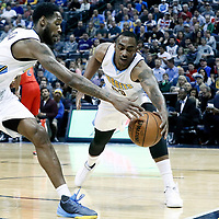 08 March 2017: Denver Nuggets forward Darrell Arthur (00) and Denver Nuggets guard Will Barton (5) reach for the ball during the Washington Wizards 123-113 victory over the Denver Nuggets, at the Pepsi Center, Denver, Colorado, USA.
