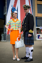 © London News Pictures. 18/06/2013. Ascot, UK.  Mimi and Douglas Theobald from Inverness pose for the media in an elaborate hat on day one of Royal Ascot at Ascot racecourse in Berkshire, on June 18, 2013.  The 5 day showcase event,  which is one of the highlights of the racing calendar, has been held at the famous Berkshire course since 1711 and tradition is a hallmark of the meeting. Top hats and tails remain compulsory in parts of the course. Photo credit should read: Ben Cawthra/LNP