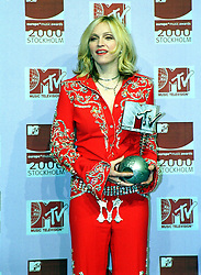 File photo dated 16/11/2000 of singer Madonna with the Best Female award at the MTV Europe Music Awards, held at the Globe Arena in Stockholm. The pop superstar will celebrate her 60th birthday on Thursday, following a long career of reinvention and controversy.