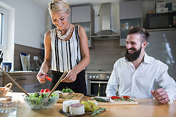 Couple preparing food in the kitchen, Bavaria, Germany