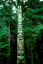 AK: Alaska Sitka National Historic Park, totem pole in rain forest  .Photo Copyright: Lee Foster, lee@fostertravel.com, www.fostertravel.com, (510) 549-2202.Image: aksitk202.