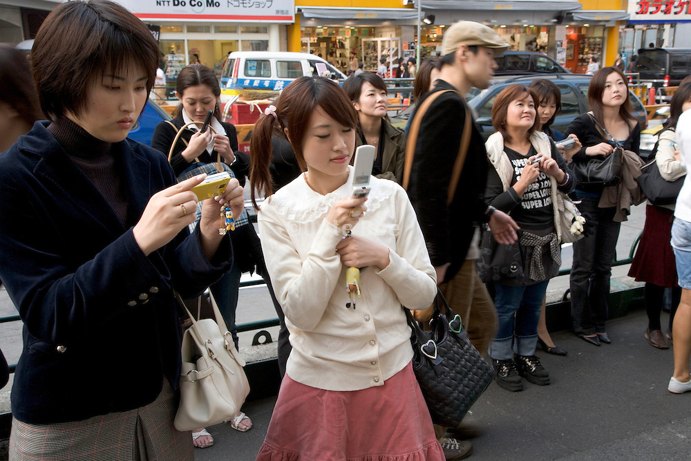 Japanese woman using her mobile phone to make a picture