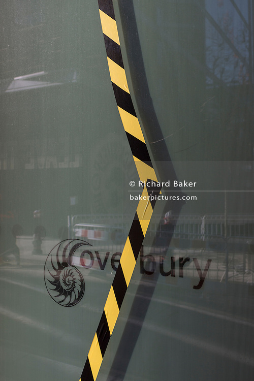 Black and white tape on the surface of damaged window glass on 13th February 2017, Overbury, in the City of London, United Kingdom.