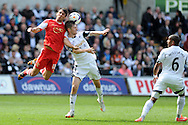 Southampton's Jack Cork (l) challenges Swansea city's Ben Davies. Barclays Premier league match, Swansea city v Southampton at the Liberty stadium in Swansea, South Wales on Saturday 3rd May 2014.<br /> pic by Andrew Orchard, Andrew Orchard sports photography.