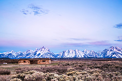 """Jackson Hole sunrise at the Cunning Cabin in Grand Teton National Park.<br /> <br /> For production prints or stock photos click the Purchase Print/License Photo Button in upper Right; for Fine Art """"Custom Prints"""" contact Daryl - 208-709-3250 or dh@greater-yellowstone.com"""
