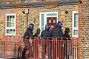 A man at his late 20's who was called by the police as M***in, is alleged to have assaulted members of the public and an emergency worker on Tuesday, Aug 18, 2020, in south London.<br /> <br /> Members of the MET police crew stormed into his barricaded doorstep after Martin wouldn't respond to their multiple calls to surrender as he was declared that he was going to be arrested.<br /> After breaking the door police stumbled into a barricade made of a ladder, washing machine, several chairs and other wood and plastic items. After forcing themselves into his apartment, police couldn't find him. The search is on-going. (VXP Photo/ Vudi Xhymshiti)