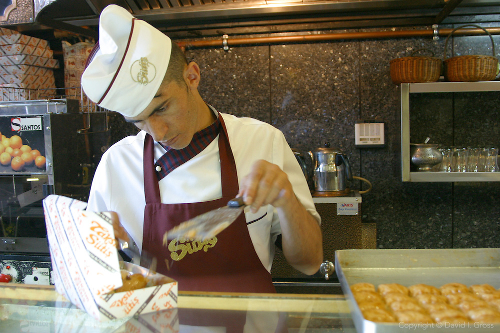 Packing sweets (Baklava) in a sweet shop on Istiklal Caddesi, the large pedestrian area of Beyoglu in Istanbul, Turkey.