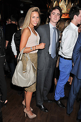 CHARLIE HARRISON and VICTORIA FISHER at the launch of the Johnnie Walker Blue Label Club held at The Scotch, Mason's Yard, London on 1st May 2012.