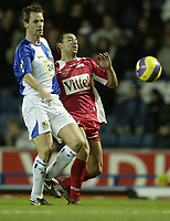 Photo: Aidan Ellis.<br /> Blackburn Rovers v AS Nancy. UEFA Cup. 13/12/2006.<br /> Rovers Andre Ooijer (L) battles with Nancy's Pascal Berenguer