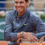 PARIS, FRANCE June 09.  Rafael Nadal of Spain with the winners trophy on Court Philippe-Chatrier after the Men's Singles Final at the 2019 French Open Tennis Tournament at Roland Garros on June 9th 2019 in Paris, France. (Photo by Tim Clayton/Corbis via Getty Images)