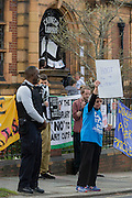 A campaigner asks motorists to hoot their support for the recently-closed Carnegie Library by Lambeth council in Herne Hill, south London as occupiers remain inside the premises on day 3 of its occupation, 3rd April 2016. The angry local community in the south London borough have occupied their important resource for learning and social hub for the weekend. After a long campaign by locals, Lambeth have gone ahead and closed the library's doors for the last time because they say, cuts to their budget mean millions must be saved. A gym will replace the working library and while some of the 20,000 books on shelves will remain, no librarians will be present to administer it.
