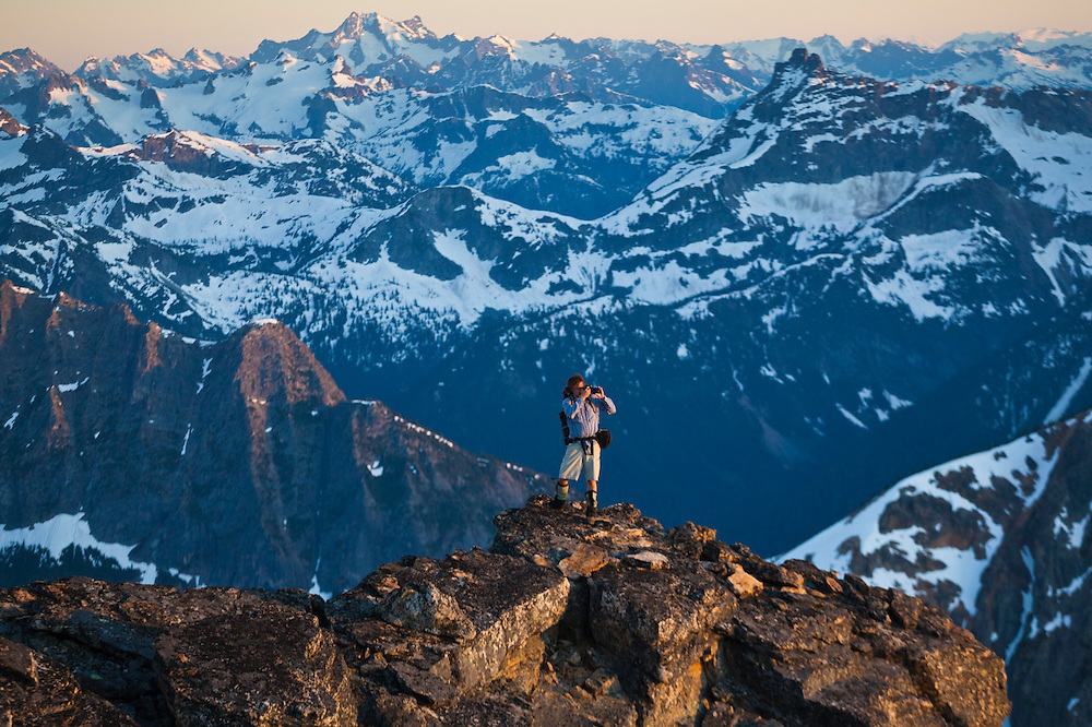 Kevin Steffa takes pictures at sunset from a ridge below Golden Horn, Okanogan National Forest, Washington.
