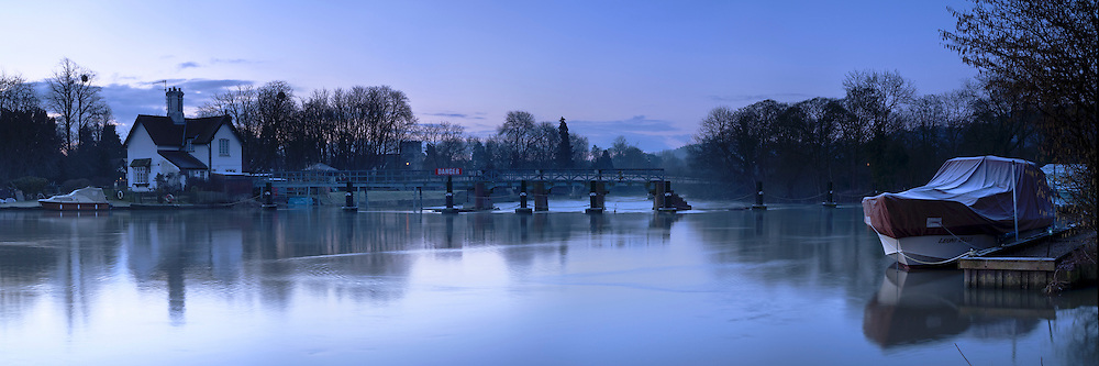 Winter dawn on the River Thames at Goring Weir, Oxfordshire, Uk