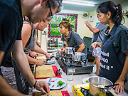 """29 MARCH 2013 - BANGKOK, THAILAND: Saiyuud Diwong """"Poo"""" leads a class at her cooking school in Klong Toey.    PHOTO BY JACK KURTZ"""