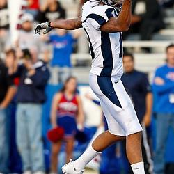 December 4, 2010; Ruston, LA, USA;  Nevada Wolf Pack quarterback Colin Kaepernick (10) celebrates as he scores a touchdown during the second half against the Louisiana Tech Bulldogs at Joe Aillet Stadium.  Nevada defeated Louisiana Tech 35-17. Mandatory Credit: Derick E. Hingle