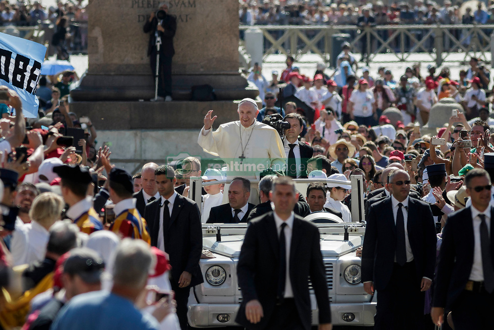 Pope Francis greets the faithful as he arrives to celebrate his Weekly General Audience in St. Peter's Square on May 31, 2017. (Photo by Giuseppe Ciccia / Pacific Press) *** Please Use Credit from Credit Field ***