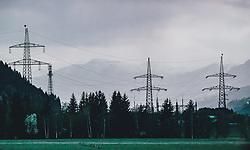 THEMENBILD - Strommasten im abendlichen Gegenlicht vor einem Regenschauer, aufgenommen am 25. April 2020 in Kaprun, Oesterreich // Power poles in the evening backlight before a rain shower, in Kaprun, Austria on 2020/04/25. EXPA Pictures © 2020, PhotoCredit: EXPA/Stefanie Oberhauser