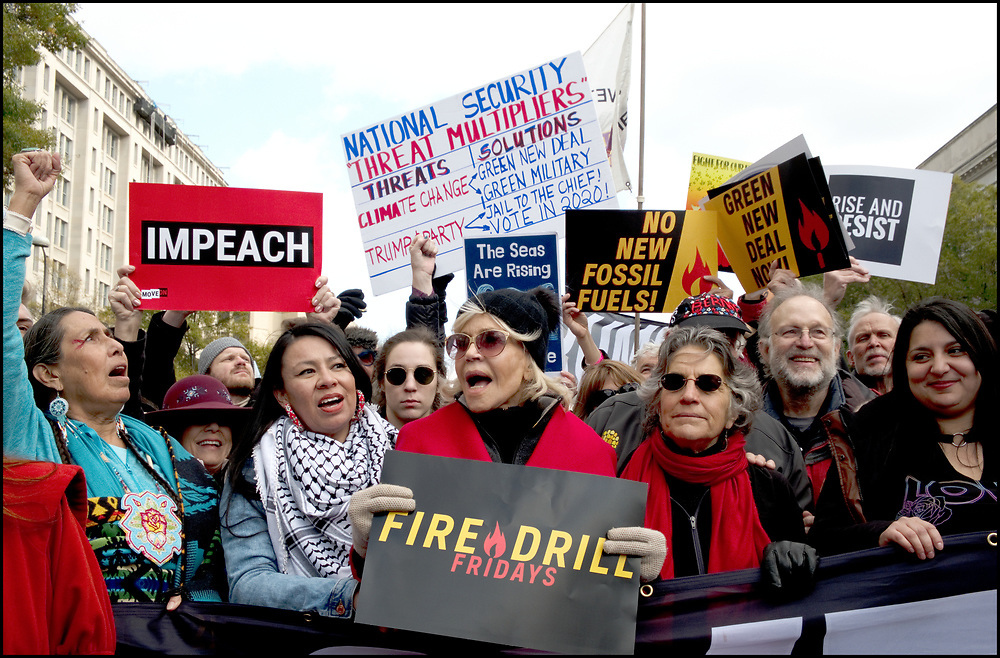 """On November 8, 2019 Remove Trump joined forces with Fire Drill Fridays, Jane Fonda, Ben Cohen and Jerry Greenfield for a March To Remove Trump from the Capital to The White House. Women's March, Rise and Resist, Veterans for Peace, and many other groups came together to participate. <br /> <br /> Along the march,  Rise and Resist members carried  a 600-square-foot impeachment clause banner.  After arriving at the White House the banner was unfurled while a group from Fire Drill Fridays blocked one of the entrances in a civil disobedience action. There were no arrests.<br /> <br /> In October of 2019, inspired by Greta Thunberg's call to act like """"our house is on fire"""" and guided by Naomi Klein's Green New Deal advocacy, Jane Fonda dropped all of her commitments and moved to DC so that — together with Greenpeace and other movement allies — she could launch """"Fire Drill Fridays,"""" which would be weekly protests centered around civil disobedience and a demand Congress pass the Green New Deal."""