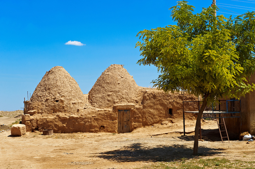 """Pictures of the beehive adobe buildings of Harran, south west Anatolia, Turkey.  Harran was a major ancient city in Upper Mesopotamia whose site is near the modern village of Altınbaşak, Turkey, 24 miles (44 kilometers) southeast of Şanlıurfa. The location is in a district of Şanlıurfa Province that is also named """"Harran"""". Harran is famous for its traditional 'beehive' adobe houses, constructed entirely without wood. The design of these makes them cool inside. 42 .<br /> <br /> If you prefer to buy from our ALAMY PHOTO LIBRARY  Collection visit : https://www.alamy.com/portfolio/paul-williams-funkystock/harran.html<br /> <br /> Visit our TURKEY PHOTO COLLECTIONS for more photos to download or buy as wall art prints https://funkystock.photoshelter.com/gallery-collection/3f-Pictures-of-Turkey-Turkey-Photos-Images-Fotos/C0000U.hJWkZxAbg ."""