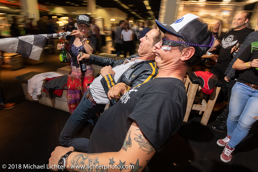 Seb and Goetz under the Limbo at the Sultans of Sprint party during the Intermot International Motorcycle Fair. Cologne, Germany. Saturday October 6, 2018. Photography ©2018 Michael Lichter.