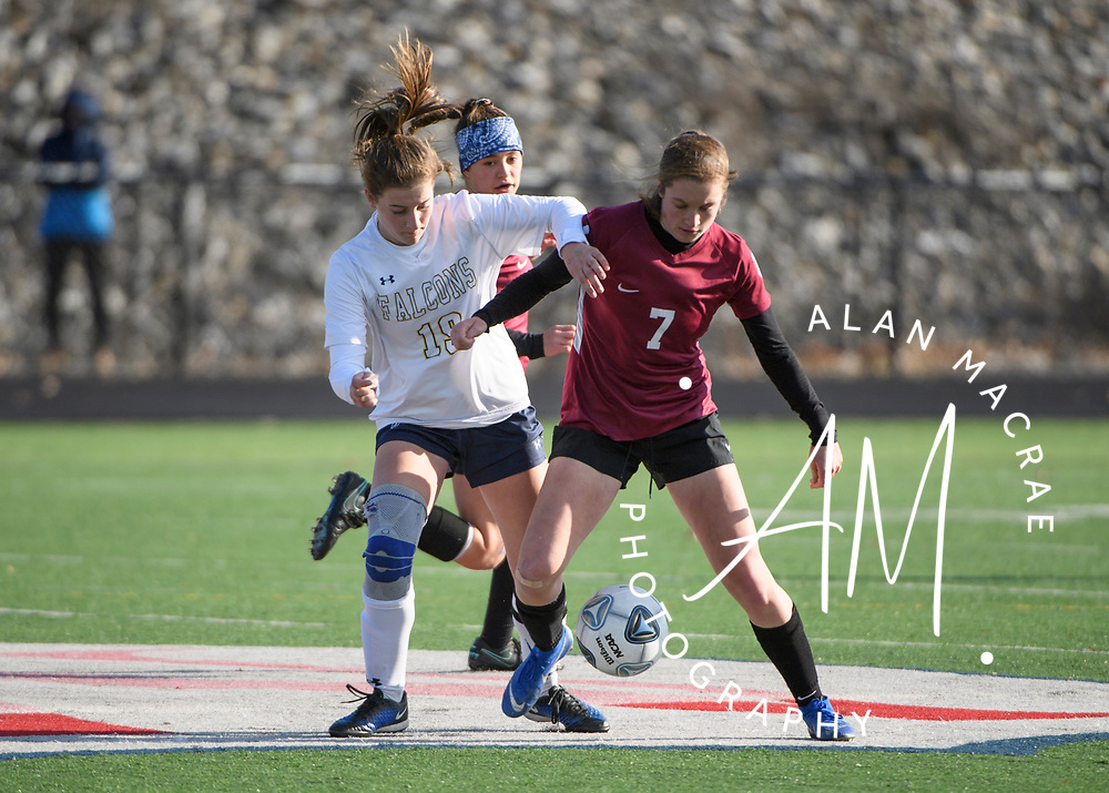 Hanover junior Ellison Stannard and Bow senior Lindsay Burnham scuffle for control of the ball during the NHIAA Division II soccer championship in Manchester on Sunday, November 10, 2019.  (Alan MacRae/Valley News)
