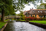 """Giethoorn is a town in the province of Overijssel, Netherlands It is located in the municipality of Steenwijkerland, about 5 km southwest of Steenwijk. As a popular Dutch tourist destination both within Netherlands and abroad, Giethoorn is often referred to as """"Dutch Venice"""" (Dutch: Hollands Venetië) or the """"Venice of the Netherlands""""."""