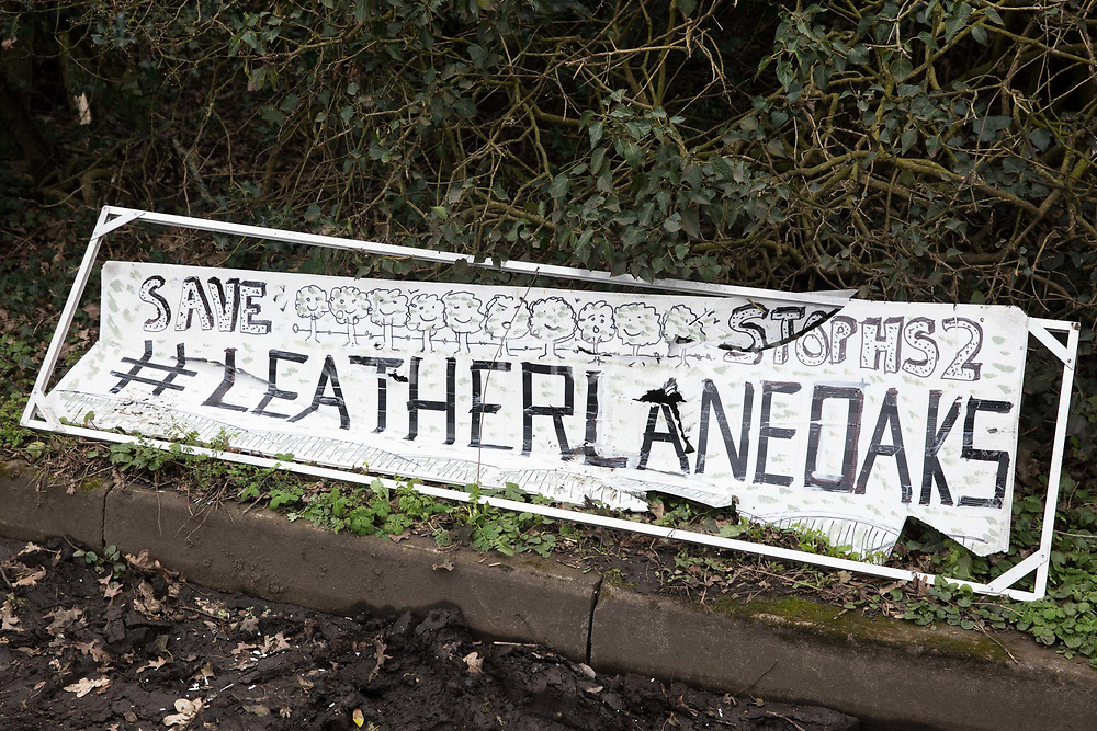 A painted sign calling for a row of hundred-year-old oak trees in Leather Lane to be saved from felling for the HS2 high-speed rail link is pictured on 18th March 2021 in Great Missenden, United Kingdom. Almost 40,000 people have recently signed a petition calling for the oak trees lining the ancient country lane not to be felled to make way for a temporary haul road and construction compound and local residents and conservationists have accused HS2 contractors of destroying active bird boxes on the site.