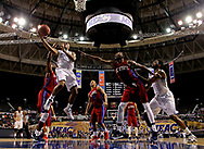Mar 12, 2016; Norfolk, VA, USA; Hampton Pirates guard Reginald Johnson Jr. (34) shoots the ball against South Carolina State Bulldogs forward Tashombe Riley (2) in the first half during the MEAC conference tournament at Norfolk Scope Arena. Mandatory Credit: Peter Casey-USA TODAY Sports