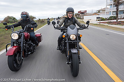 Iron Lilly Leticia Cline (R) on a new 2017 Harley-Davidson 750 Street Rod alongside custom bike builder Jesse Rooke on a 2017 Harley-Davidson Road King Special as they ride AIA near Flagler Beach during Daytona Beach Bike Week. FL. USA. Tuesday, March 14, 2017. Photography ©2017 Michael Lichter.