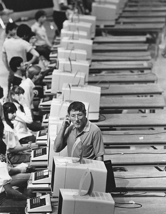 ©1989 man at college registration center, Austin