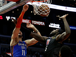 March 8, 2019 - Los Angeles, California, U.S - Oklahoma City Thunder's Abdel Nader (11) goes to basket and gets fouled by Los Angeles Clippers' Montrezl Harrell (5) during an NBA basketball game between Los Angeles Clippers and Oklahoma City Thunder Friday, March 8, 2019, in Los Angeles. (Credit Image: © Ringo Chiu/ZUMA Wire)
