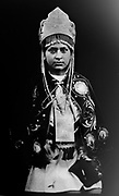 """In this June 12, 2017 photo taken with a 19th century style box camera, 21-year-old Nelida Soto poses for a portrait in the Sinakara Valley, during the Qoyllur Rit'i festival. Soto, who represents the Tahuantinsuyo nation, performs in a dance called """"Chunchaca"""" which venerates Our Lady of Mount Carmel known locally as Mamacha Carmen. """"Mamacha"""" is Quechua for the word """"virgin""""."""