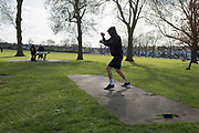 As the second week of the Coronavirus lockdown continues and a week before Easter when Prime Minister Boris Johnson reminds Britons to stay locally and not to travel to beauty spots, the UK death toll rises to 2,921, with 1m cases of Covid-19 worldwide in 181 countries. Michial, a middle-weight from Brooklyn spars with a boxing app on his phone in afternoon sunshine and spring temperatures in Ruskin Park in Herne Hill, 3rd April 2020, in south London, England.