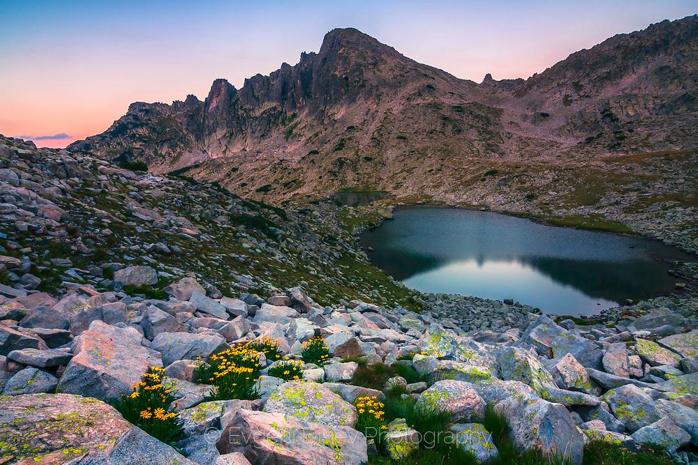 Dark mountain lake at twilight hour