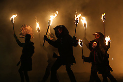 © Licensed to London News Pictures. 06/02/2016. Marsden, UK. Masked revellers carry torches through the mist during the spectacular Imbolc fire festival in Marsden, West Yorkshire, UK. Based on ancient pagan traditions, Imbolc is a Gaelic festival celebrating the end of winter and the coming of spring. The focal point of the event is the face-off between the Green Man, who represents the coming spring, and Jack Frost, winter - with the former coming out on top. Photo credit : Ian Hinchliffe/LNP
