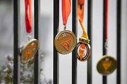 © Licensed to London News Pictures. 11/04/2020. Stoneleigh, UK. Kevin Webber's Marathon des Sables ultramarathon race medals are displayed in his Surrey garden during lockdown. Kevin has run the entire 230Km (143 miles) 6 stage race in his small back and front gardens, completing 2734 laps, over 6 days - finishing today. Kevin, who was diagnosed with terminal prostate cancer just over 5 years ago was due to take part in his 5th consecutive running of what is described as the 'toughest foot race on Earth' through the Sahara Desert in Southern Morocco this month, but the 2020 six day race has been postponed until September.  Kevin is raising funds for the National Emergencies Trust Coronavirus Appeal who will distribute the funds to where they are needed most in the UK and he will jointly split what he raises with Prostate Cancer UK. Photo credit: Peter Macdiarmid/LNP