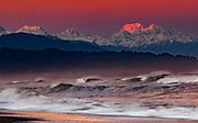 Winter alpenglow at dawn, East Face Aoraki Mount Cook from West Coast beach near Hokitika, New Zealand.