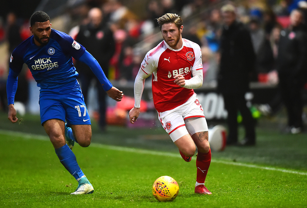 Fleetwood Town's Kyle Dempsey competes with Peterborough United's Alex Penny<br /> <br /> Photographer Richard Martin_Roberts/CameraSport<br /> <br /> The EFL Sky Bet League One - Fleetwood Town v Peterborough United - Sunday 17th December 2017 - Highbury Stadium - Fleetwood<br /> <br /> World Copyright © 2017 CameraSport. All rights reserved. 43 Linden Ave. Countesthorpe. Leicester. England. LE8 5PG - Tel: +44 (0) 116 277 4147 - admin@camerasport.com - www.camerasport.com
