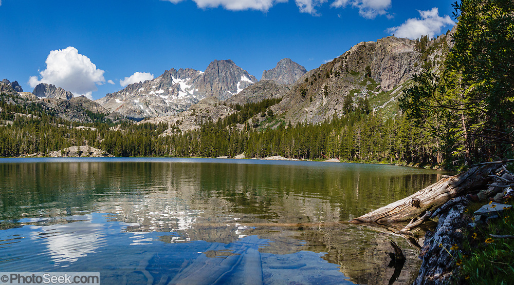Mount Ritter and Banner Peak reflect in Shadow Lake (7.5 miles,  1200 ft gain) in Ansel Adams Wilderness, Inyo National Forest. Mammoth Lakes, California, USA. Multiple overlapping photos were stitched to make this panorama.