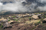 Clouds roll over the historical  town of the Q'eros people, high in the Cordillera de Paucartambo, Andes Mountains, Peru on September 15, 2005. Most Q'eros live at higher elevations during the dry season to herd alpaca, but potatoes and other staples are grown in this village, at a lower altitude of 11,000 feet. The Q'eros, a Quecha people living in the Peruvian Andes, are considered the last direct descendants of the Incas and proudly maintain many of the ancient traditions.