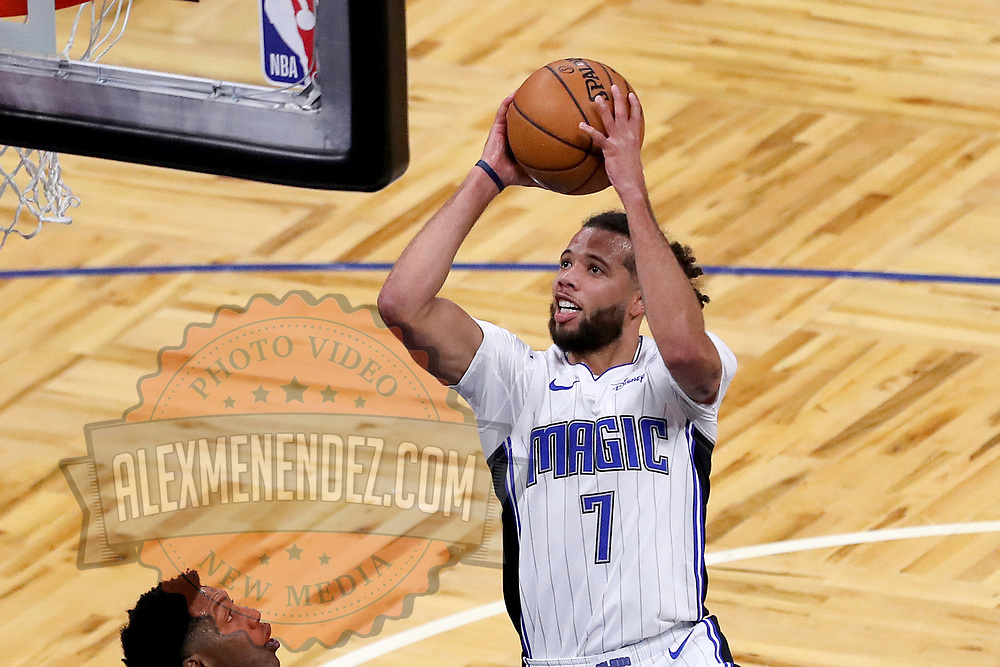 ORLANDO, FL - FEBRUARY 17:   Michael Carter-Williams #7 of the Orlando Magic drives to the net against the New York Knicks at Amway Center on February 17, 2021 in Orlando, Florida. NOTE TO USER: User expressly acknowledges and agrees that, by downloading and or using this photograph, User is consenting to the terms and conditions of the Getty Images License Agreement. (Photo by Alex Menendez/Getty Images)*** Local Caption *** Michael Carter-Williams